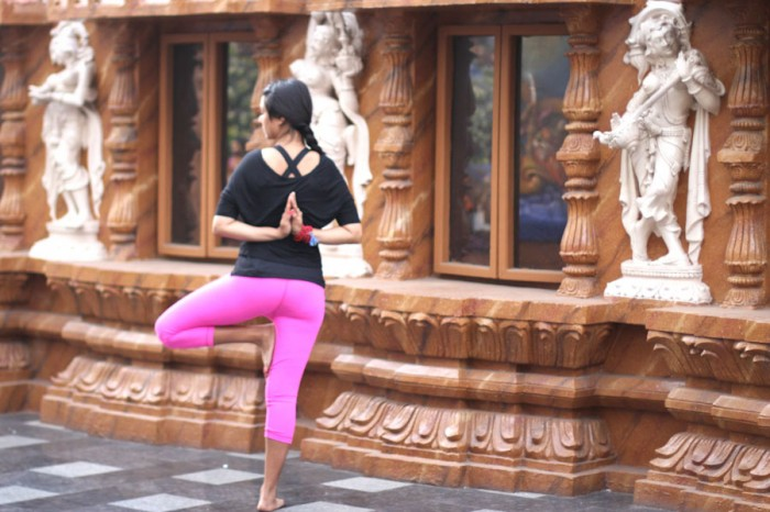 The author, Sweta Saraogi, in Vriksasana, or tree pose, at a temple in Hyderabad, India. (Courtesy photo)