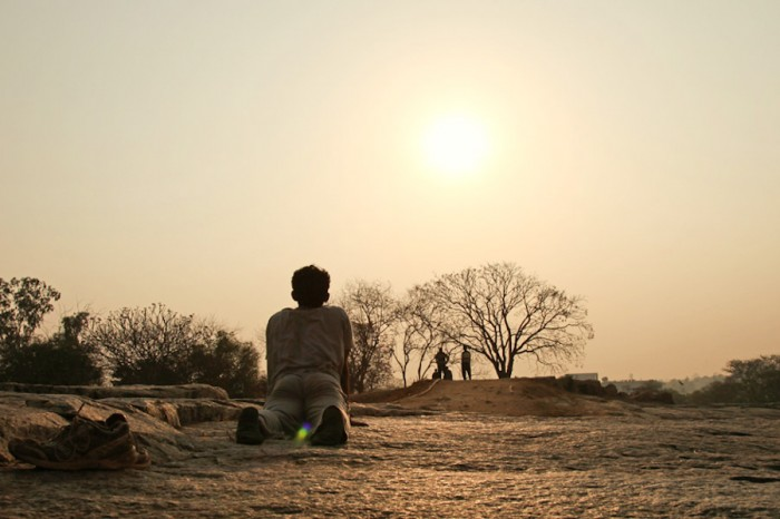 An Indian man practices yoga at dawn near Bangalore. (Photo by Vinoth Chandar)